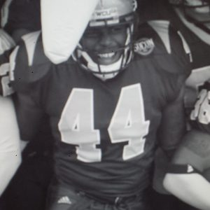 Chaz Jackson Motivational Youth Speaker in football uniform