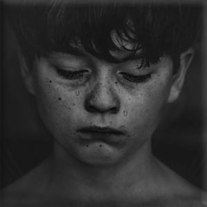 Black and white image of a sad boy with tears on his face Chaz Jackson How to prevent bullying